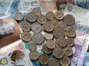 image of money for blog by Burnett Mortgages on do mortgage brokers charge a fee